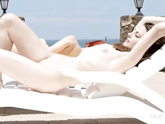 Gorgeous naked girls are having fun at the pool
