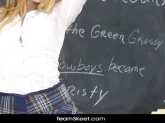 Skinny blonde is taking exciting poses on teacher's desk