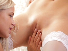 Awesome young blonde lesbians in hot lingerie are licking off