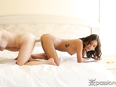Janice Griffith and Taylor Whyte are sitting on top of Johnny Castle and hotly kissing